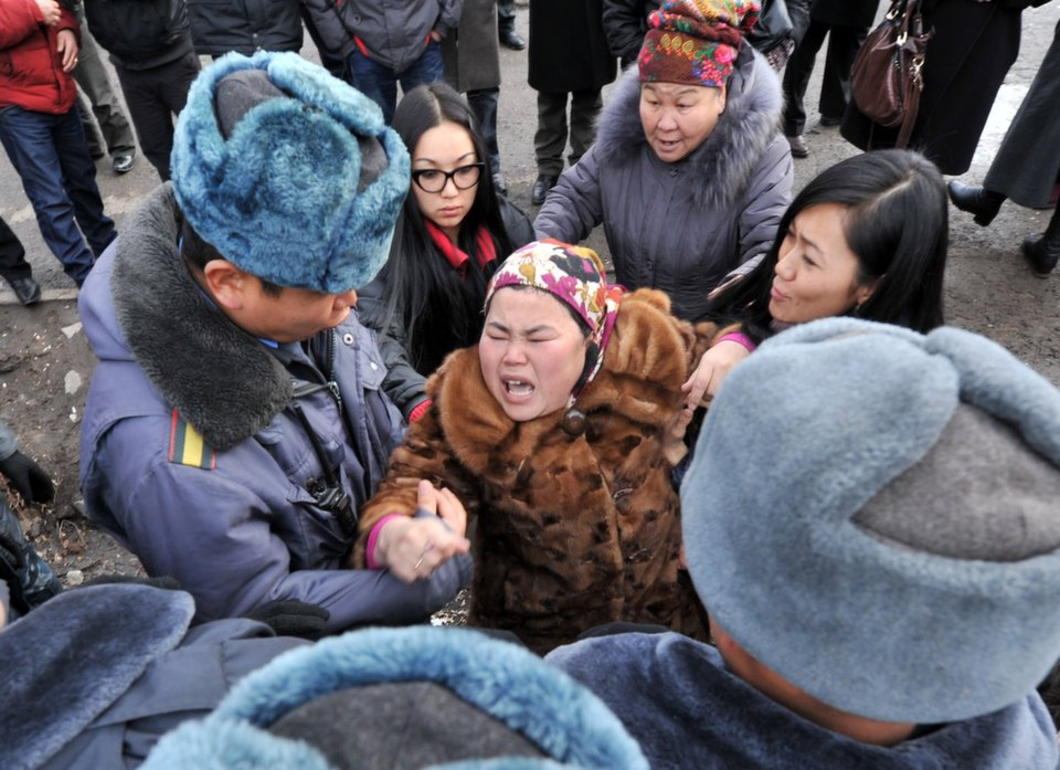 Supporters of the  detained opposition lawmakers protest in front of a court in Kyrgyzstan's  capital, Bishkek, on Jan. 25, 2013. The head of the nationalist opposition Ata-Zhurt  party, Kamchybek Tashiev, was arrested last year along with two other lawmakers  over their role in a protest demanding the nationalization of the  Canadian-owned Kumtor mine.       VYACHESLAV  OSELEDKO/AFP/Getty Images
