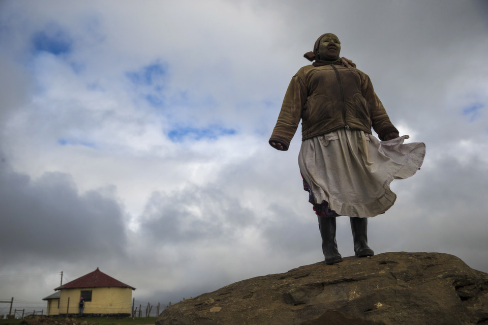 """A Xhosa woman  poses on a rock overlooking Qunu, South Africa ahead of the funeral of former  South African President Nelson Mandela on Dec. 12, 2013. Mandela passed  away on the evening of Dec. 5, 2013 at his home in Houghton at the age of  95. Mandela became South Africa's first black president in 1994 after spending  27 years in jail for his activism against apartheid in a racially-divided South  Africa. Following his death, Foreign Policy's J. Dana Stusterwrote about the secret  history of Mandela'sfavorite  poem,John Campbell considered the myths  that have shaped Mandela's legend, and FP also ran this slideshow titled, """"Remembering a Giant of Justice,"""" featuring highlights from Mandela's memorial service.      Photo by Dan  Kitwood/Getty Images"""