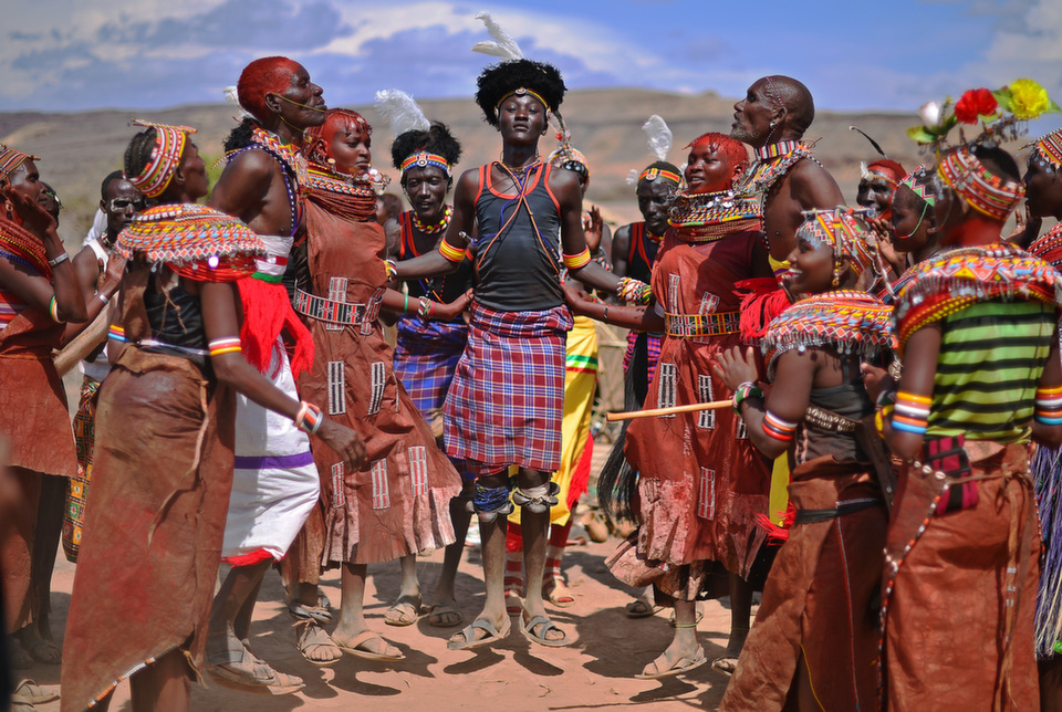 """Members of the Rendile tribe and the Turkana tribe dance before total  hybrid eclipse in Sibiloi National Park in Turkana on Nov. 3, 2013.  Astronomy enthusiasts in Kenya caught a partial glimpse of a rare """"Hybrid Total  Eclipse"""" which hasn't been witnessed in Africa for over 40 years.      CARL DE SOUZA/AFP/Getty  Images"""