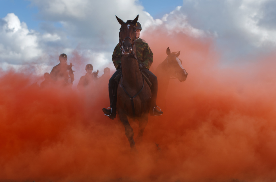 A horseman rides  his horses through colored smoke during a practice session at the beach of  Scheveningen on Sept. 16, 2013 in the Netherlands. Some 80 members of  the Dutch cavalry practiced for any possible emergency during the Prinsjesdag  ceremony, which marks the opening of the Dutch parliament.       Jasper  Juinen/Getty Images