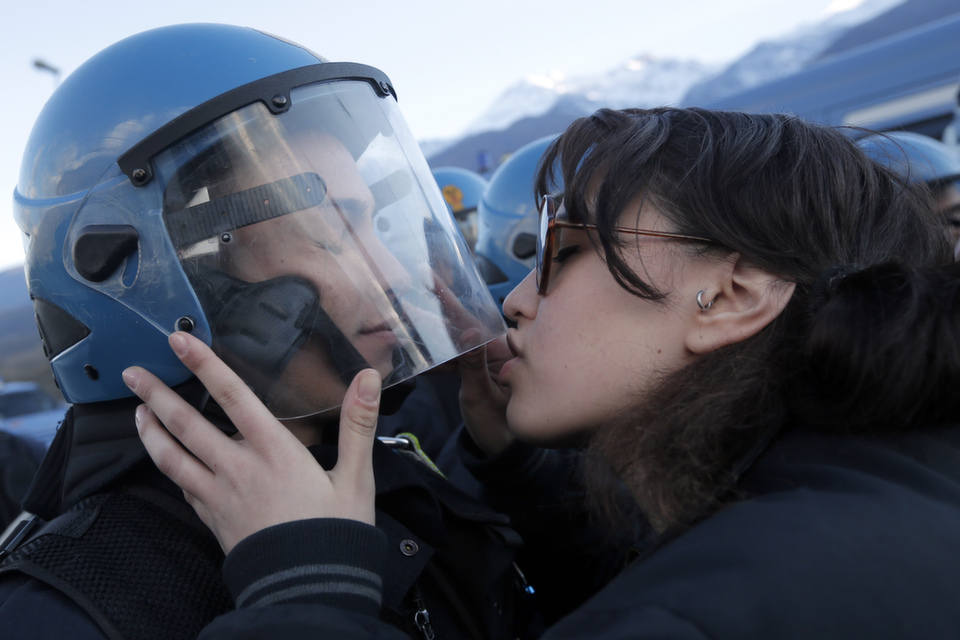 """A demonstrator  kisses a riot police officer on Nov. 16, 2013 during a protest in Susa  against the high-speed train line between Lyon and Turin. Since then, Italian authorities haveaccusedthe demonstrator of """"sexual violence and insulting a public official.""""The train, expected to  come into service in 2025, will see one million fewer trucks on the highways a  year, and reduce train times between Paris and Milan from seven hours to just  over four.       MARCO  BERTORELLO/AFP/Getty Images"""