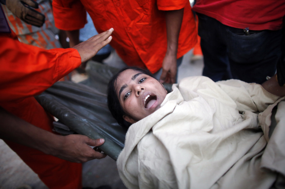 A garment worker reacts after being rescued following  the Rana Plaza building collapse in Savar on April 24, 2013. A block populated  with garment factories and shops collapsed in Bangladesh in April killing 1,127 people, according to aMay report. Later that month, Joseph Allchinreportedfor Foreign Policy on how Bangladesh's garment  industry came to dominate the country's export industry.      REUTERS/Andrew Biraj