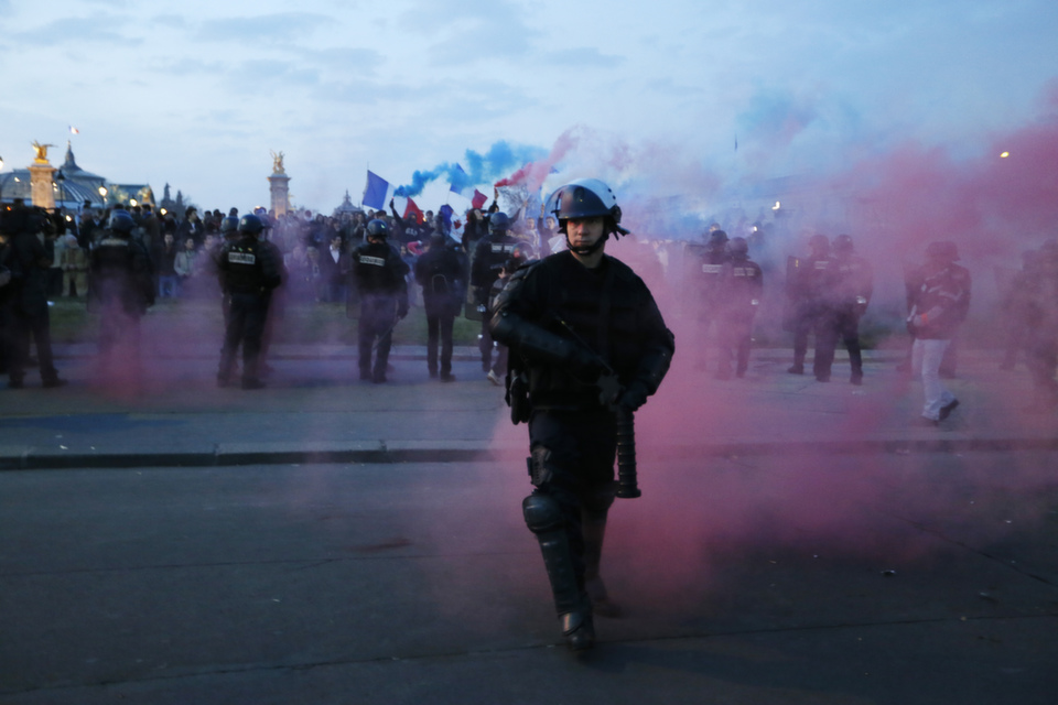 Riot police surround protesters at the end of a demonstration called La Manif Pour Tous (Demonstration For All) which gathered tens of thousands of opponents of a gay marriage bill  on Apr. 21, 2013 in Paris.       KENZO TRIBOUILLARD/AFP/Getty Images