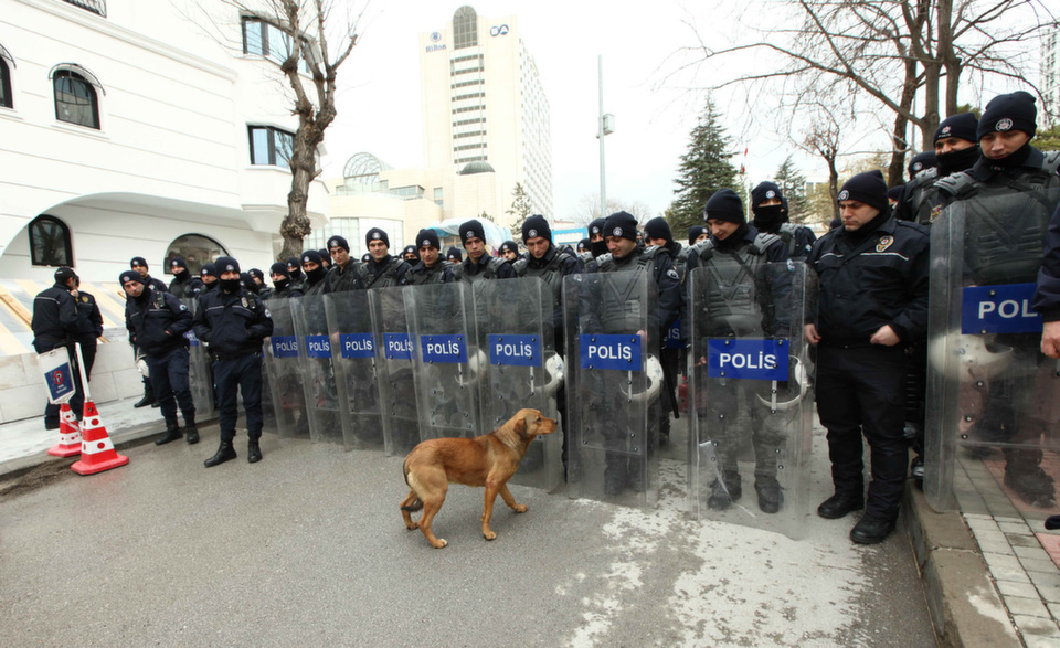 Riot police block protesters approaching the Iranian Embassy in  Ankara on Jan. 29, 2013. Protesters marched against the conviction of two  jailed Kurdish politicians, brothers Lokman and Zanyar Muradi, in Iran.      ADEM ALTAN/AFP/Getty Images