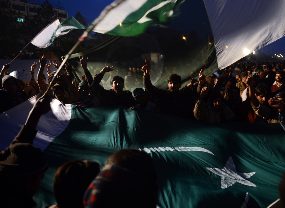Supporters of  Pakistani cleric Tahir-ul Qadri wave flags as they chant slogans on  the third day of a protest rally in Islamabad on Jan. 16, 2013. The populist  cleric urged Pakistani politicians to join tens of thousands taking part in the  largest protest in Islamabad for years, ratcheting up the pressure on the  government to step down.       ASIF  HASSAN/AFP/Getty Images