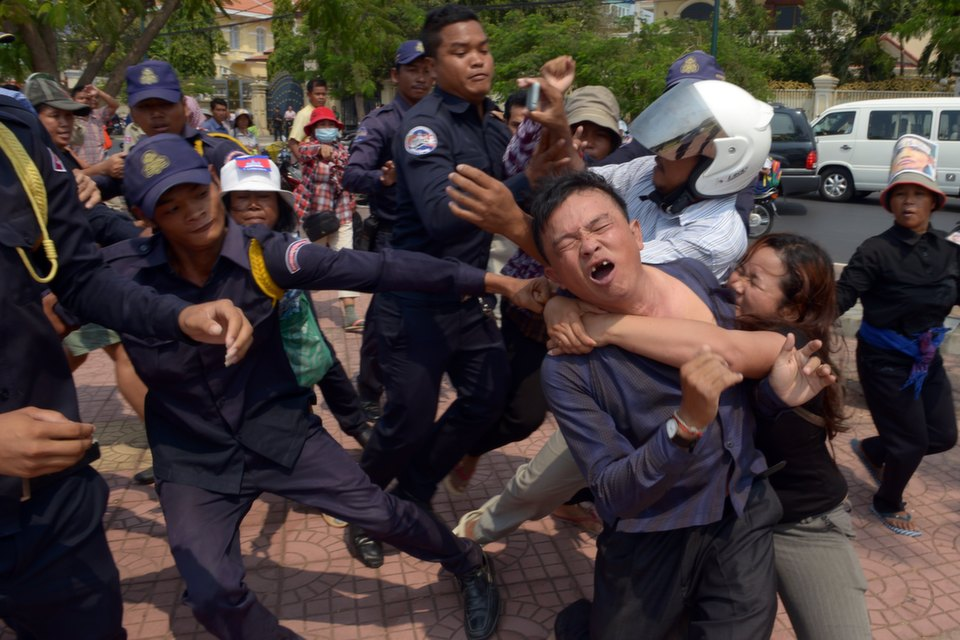 Cambodians  from Boeung Kak lakeside community clash with police and security guards at a  park near Prime Minister Hun Sen's house in Phnom Penh on Mar. 13, 2013. Land  conflicts are Cambodia's most pressing human rights issue and protests have  intensified in the last year amid what rights groups say is a worsening  crackdown on human rights activists.       TANG CHHIN  SOTHY/AFP/Getty Images