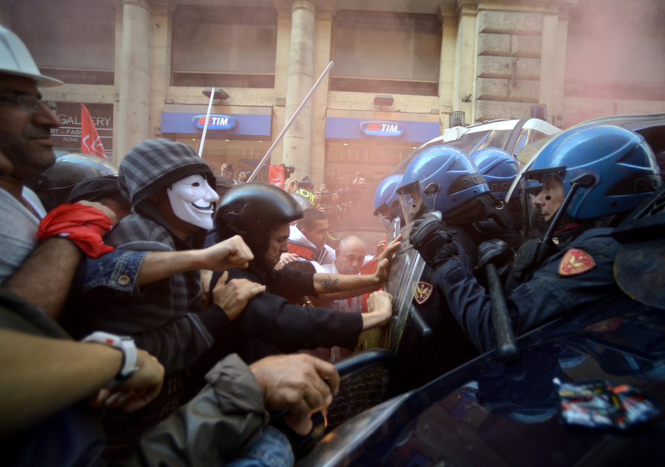 Protesters clash with anti-riot police during a demonstration against the government's austerity measures on  Oct. 31, 2013 in downtown Rome.       FILIPPO MONTEFORTE/AFP/Getty Images