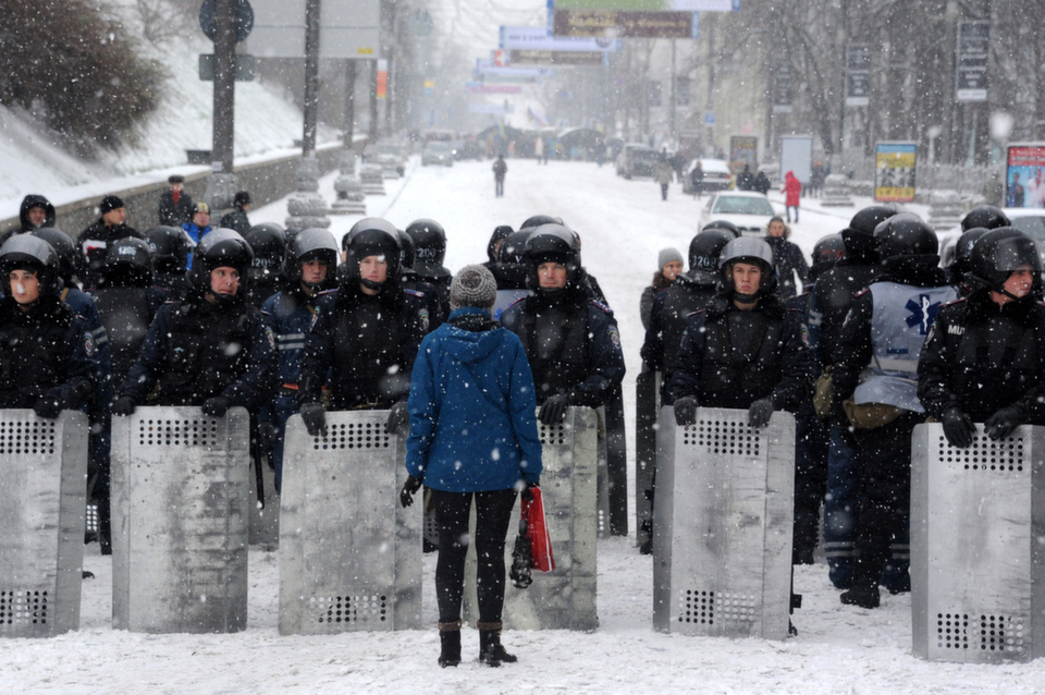 A protester talks  to riot police blocking Khreshatyk street in Kiev city center on Dec. 9,  2013. Hundreds of thousands had filled Independence Square the day before, to  denounce President Yanukovych's rejection of an EU pact under Kremlin pressure.  It was one of the biggest protests since the 2004 Orange Revolution.       VIKTOR  DRACHEV/AFP/Getty Images