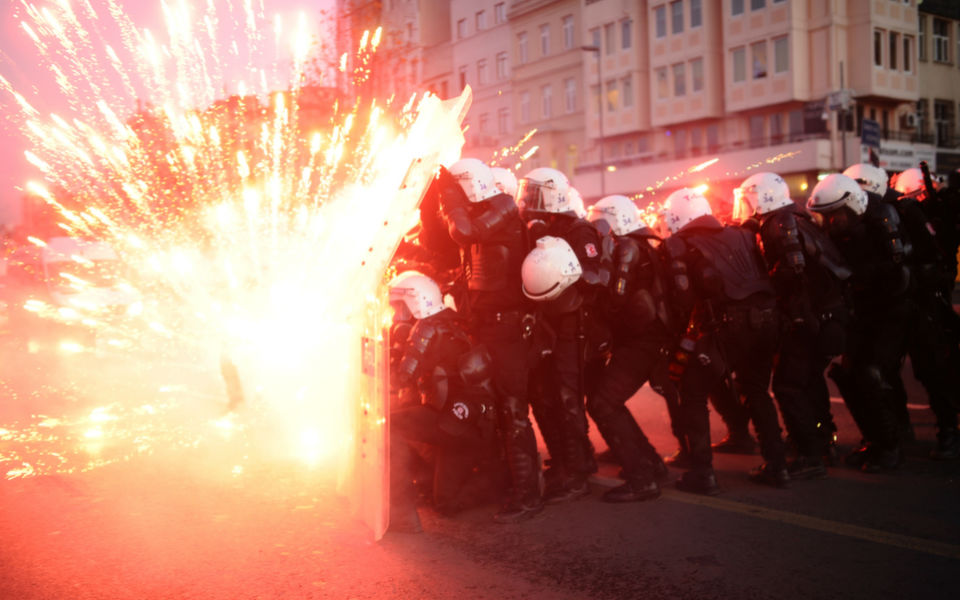 Turkish riot  police officers take cover as Kurdish protesters shoot fireworks at them during  clashes in central Istanbul on Dec. 7, 2013. Two protesters were killed on  Dec. 6 in armed clashes with Turkish police that erupted over claims that  Kurdish rebel cemeteries had been destroyed, local media reported. Some 30  masked men in a group of around 150 demonstrators hurled Molotov cocktails and  hand grenades at security forces in the Yuksekova district of Kurdish-dominated  southeastern Turkey.      BULENT KILIC/AFP/Getty  Images