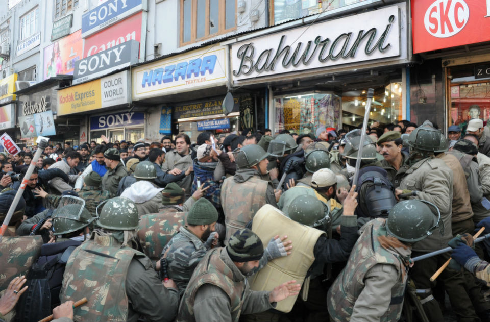 Indian police try  to stop the leaders and supporters of the pro-India Peoples Democratic Party during a protest in the capital of the Kashmir region, Srinagar, on Jan. 5, 2013. The region's main  opposition party took to the streets to march against corruption.       ROUF  BHAT/AFP/Getty Images