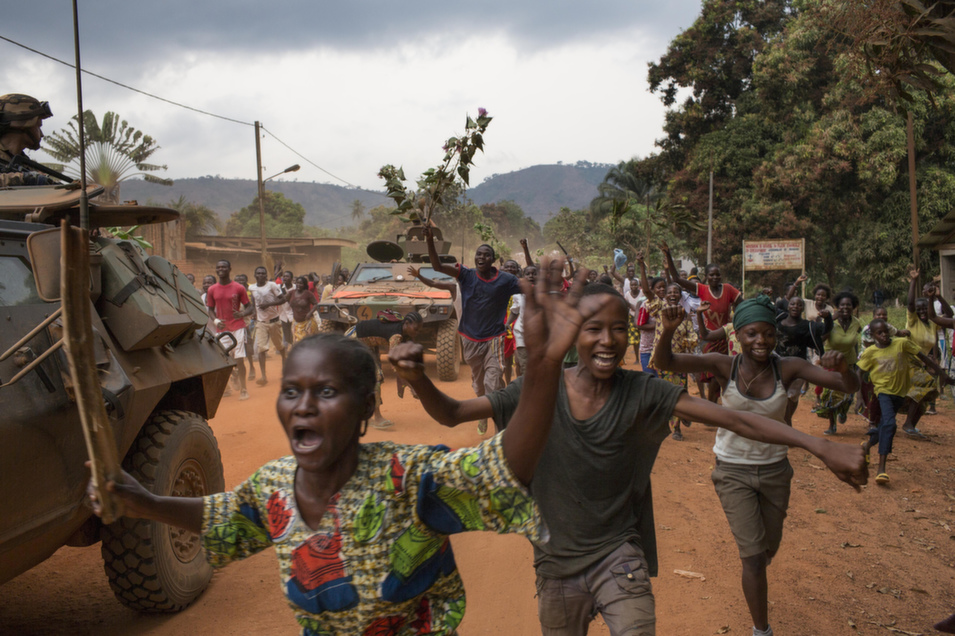 Civilians living close to   the Seleka Camp Kasai celebrate on Jan. 28 as the Muslim militia is removed from a nearby government military base that it had occupied for the last nine months.      Marcus Bleasdale/VII