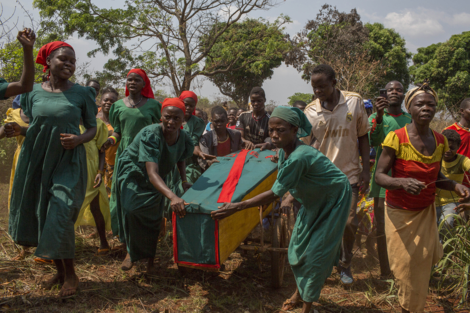 A funeral is held for Regina Yapoutou, a 24-year-old woman  from Birlo on Jan. 26. Yapoutou became sick while living in the bush, hiding from Seleka fighters  for nine months. After she returned home, her  condition worsened, and because she didn't have access to medication, she passed away.       Marcus Bleasdale/VII