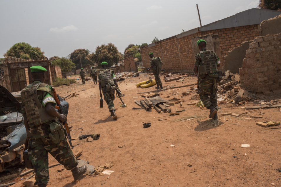 Rwandan troops move into PK13 in an attempt to stop looting by Christian  members of the community, on Jan. 23. They engaged by force and cleared the  area.       Marcus Bleasdale/VII