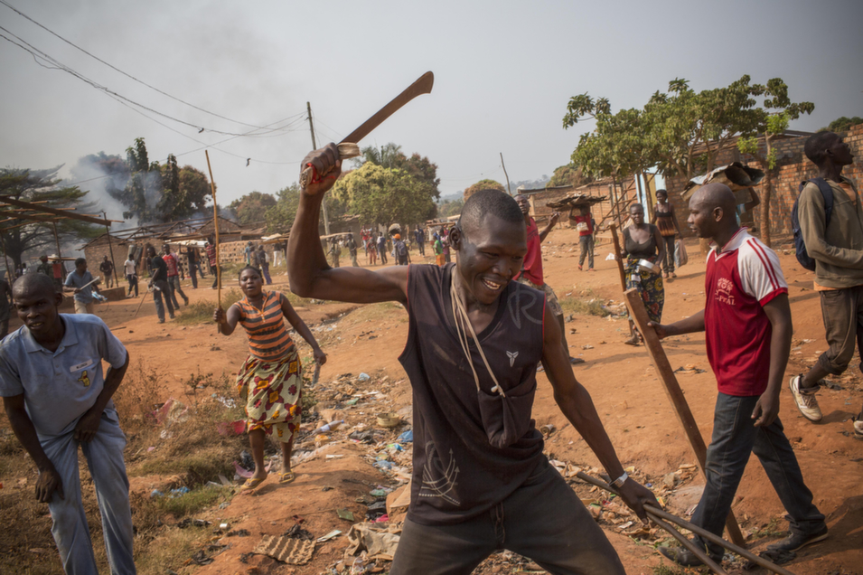 Anti-balaka forces destroy property in a Muslim community in CAR on Jan. 23.       Marcus Bleasdale/VII