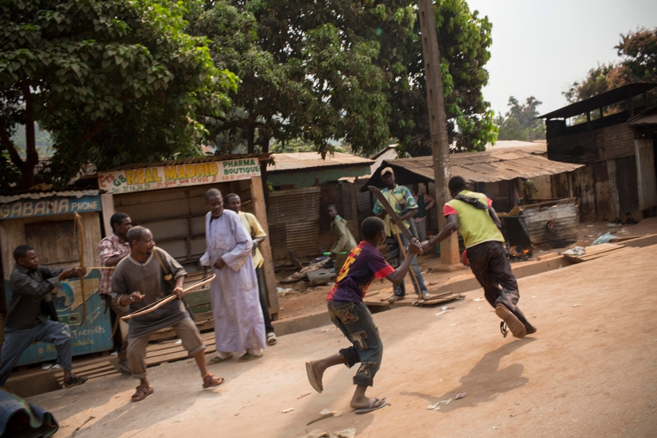 A Christian market worker in Bangui is attacked by Muslims, angry after one member of their community was killed and another gravely injured, on Jan. 23. This group attempted to  lynch the first non-Muslim they could find, but he escaped.       Marcus Bleasdale/VII