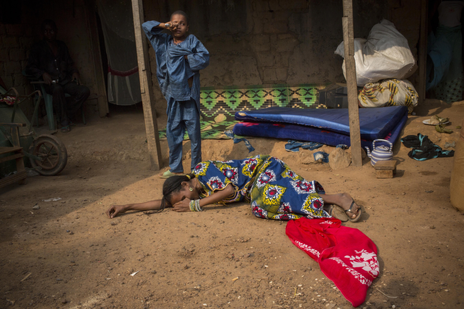 The wife of Nana Abdul Karim, a 34-year-old father of eight,  screams and faints on Jan. 23 after learning that her husband has been killed. Karim was shot by French soldiers while buying breakfast  for his children. The soldiers claim that he fired at them with a hunting rifle.       Marcus Bleasdale/VII