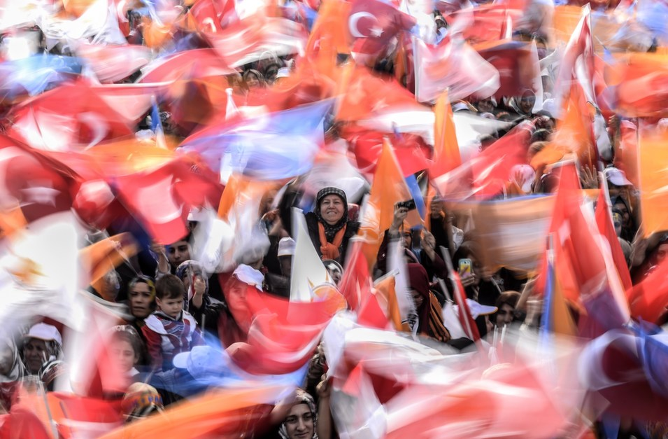 Supporters of Turkey's  prime minister cheer and wave Turkish and AK Party (AKP) flags during an  election rally in Istanbul on March 23.       BULENT KILIC/AFP/Getty  Images