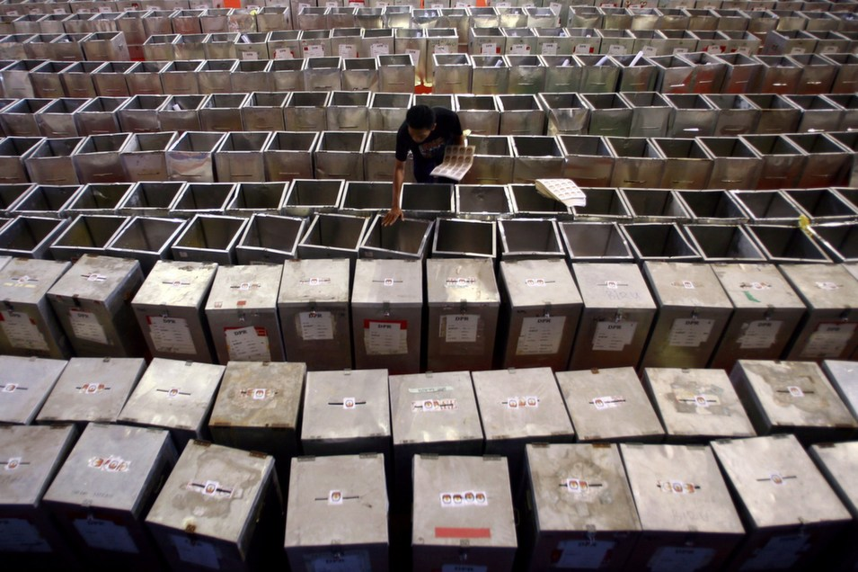 A member of  Indonesia's election commission prepares ballot boxes and polling materials in  Bangkalan, Madura island in East Java province on March 26 in preparation for  the legislative elections on April 9.       JUNI KRISWANTO/AFP/Getty  Images