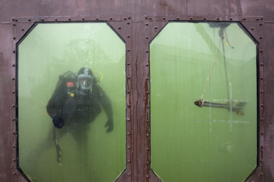 Military diver Lance  Corporal Shane Johns takes part in an exercise in a diving tank as the British Army  showcases its future specialist capabilities with a new division called Force Troops  Command, at Upavon Airfield in Upavon, England, on March 26.       Oli Scarff/Getty Images