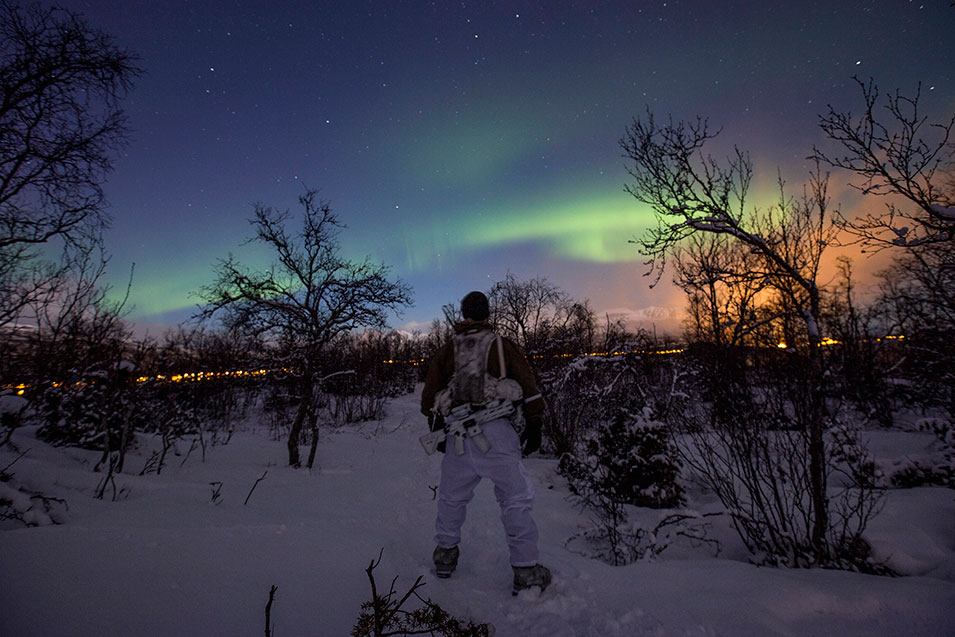 A Norwegian coastal  ranger enjoys the spectacular northern lights during Exercise  Cold Response  in northern Norway.       Morten Opedal, Norwegian Navy
