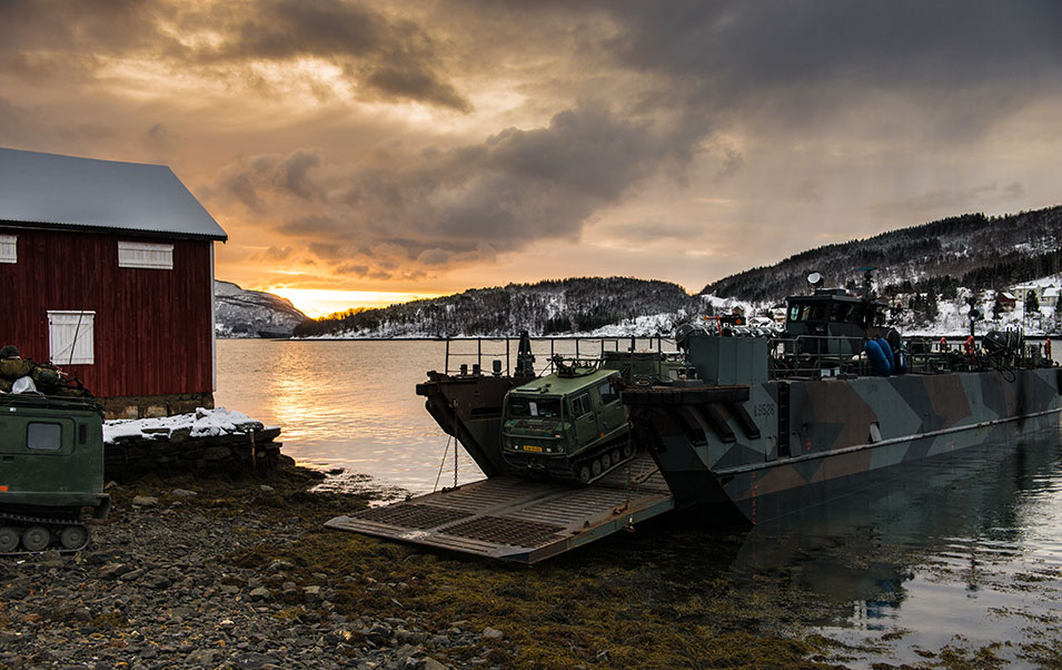 An amphibious landing  craft from the Dutch navy disembarks troops at the idyllic village of Sørreisa in northern Norway.       Ole-Sverre Haugli,  Norwegian Armed Forces