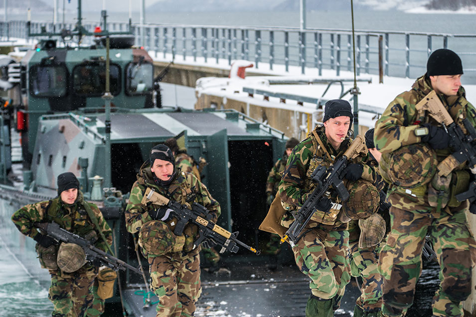 Dutch marines charge out of an amphibious  landing craft. They have deployed from the much larger HNLMS Rotterdam, farther offshore in the fjord.      Ole-Sverre Haugli,  Norwegian Armed Forces