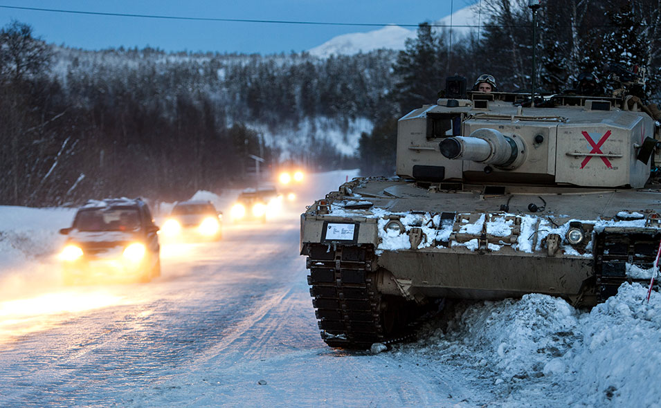 In Western  countries, military exercises normally are conducted  inside restricted military areas. Exercise Cold  Response, however, often stages among civilian populations in an area about the size of Belgium. Above, a tank from the Norwegian Telemark Battalion readies for  battle on the busiest main road in northern Norway while civilians drive the same route.       Anette Ask, Norwegian  Armed Forces