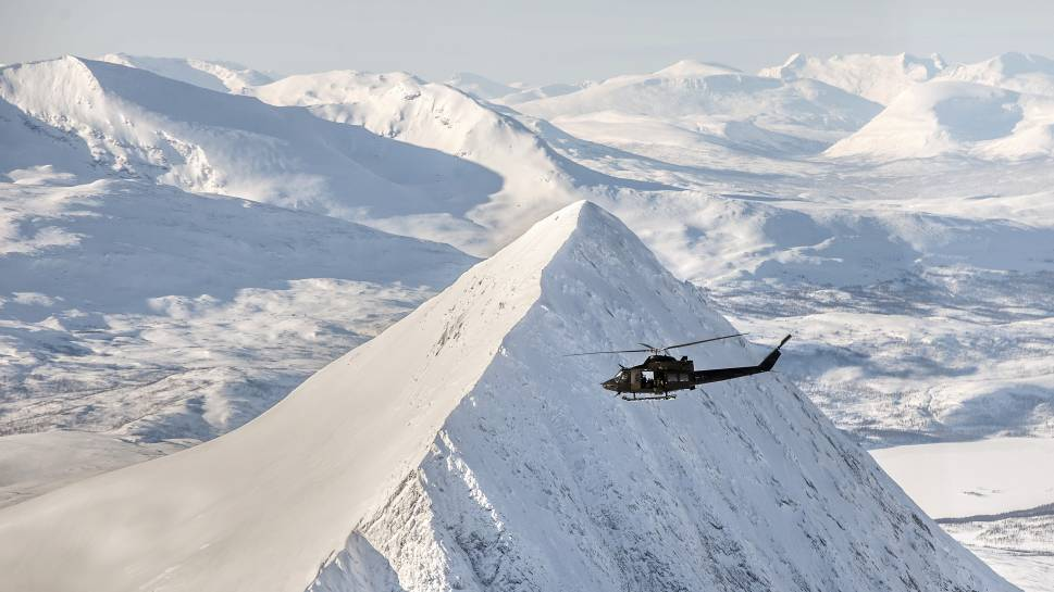 The Norwegian  Air Force's 339 Squadron trains in  this challenging terrain by practicing flying its Bell 412 helicopters.       Lars Magne Hovtun,  Norwegian Armed Forces