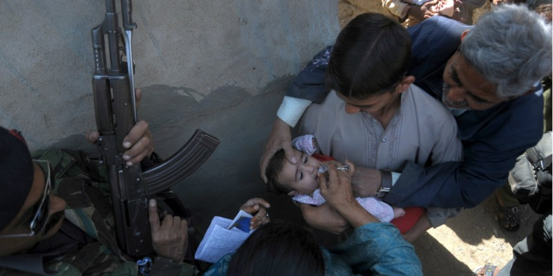 Photo: RIZWAN TABASSUM/AFP/Getty Images; Chart: Global Polio Eradication Initiative