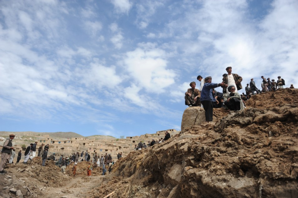Afghan villagers search through dirt and debris at the scene in  the landslide-hit Aab Bareek village in the Argo district of Badakhshan on May  5. Some 2,100 people are believed to be dead, according to the New York Times.      FARSHAD USYAN/AFP/Getty Images