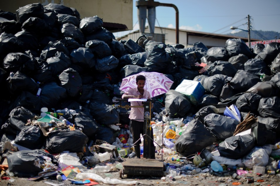 A worker stands near recycling waste in Ampang, Malaysia on May  5.      MOHD RASFAN/AFP/Getty Images