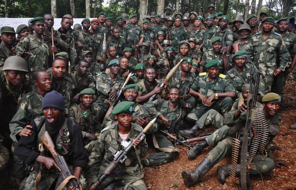 Members of the Armed Forces of the Democratic Republic of Congo  (FARDC) pose for a picture during a visit by the chief of Defence Forces of  Uganda (UPDF) in Beni in North Kivu on May 7. UPDF chief General Edward Katumba  Wamala visited the troops taking part in an ongoing military operation against  Allied Democratic Forces (ADF) rebels in the area.       STRINGER/AFP/Getty Images