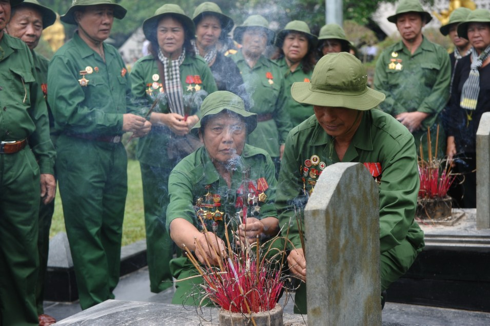Vietnamese veterans in Vietcong uniforms pay homage to  Vietnamese soldiers killed during the Dien Bien Phu battle at the official  military cemetery in the northwestern town of Dien Bien Phu on May 6. Vietnam  celebrated the 60th anniversary of its victory over France at the Dien Bien Phu  battle in 1954, on May 7.      HOANG DINH NAM/AFP/Getty Images
