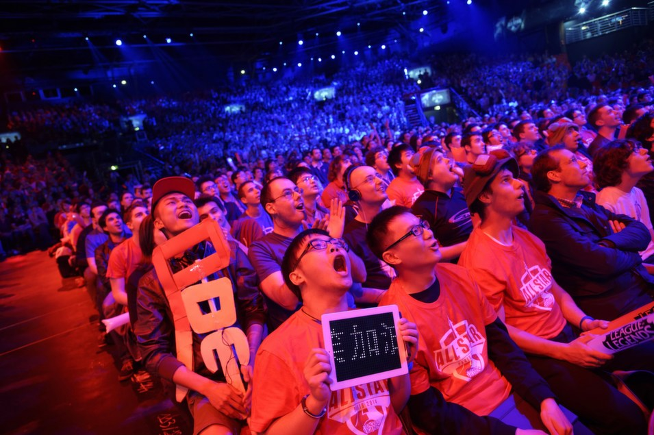 """Visitors cheer for international teams during the tournament of  the computer game """"League of Legends"""" on May 8, in Paris. Launched late in 2009  by American video game publisher Riot Games, """"League of Legends"""" is a game in  which teams of five players compete in a virtual arena, killing each other  using different powers and equipments in the goal to capture the enemy base. According to Riot Games, more than 67 million  people play each month, with peaks of more than 7.5 million concurrent players  at peak hours.       LIONEL BONAVENTURE/AFP/Getty Images"""