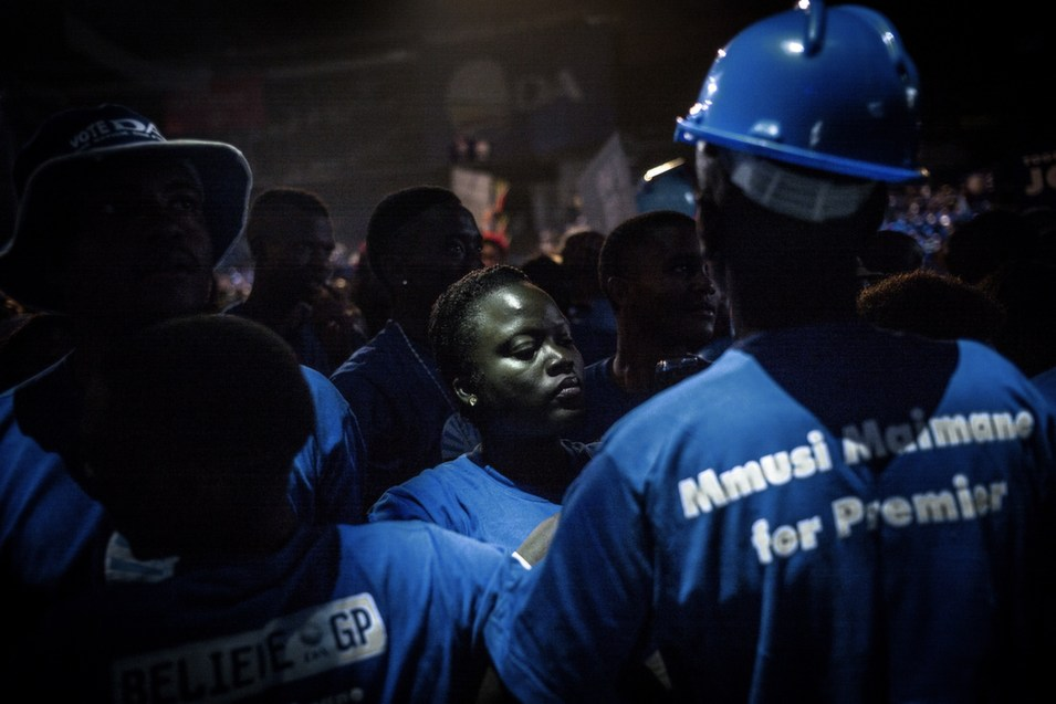 """Supporters of the opposition party Democratic Alliance (one of  them wearing a """"Mmusi Maimane for Premier"""" T-shirt) flock into the venue of its  final campaign rally in Johannesburg on May 3, ahead of the May 7 general  election. The Democratic Alliance held its final campaign rally at a vast  events center in Johannesburg's upmarket suburb of Northriding.       MARCO LONGARI/AFP/Getty Images"""