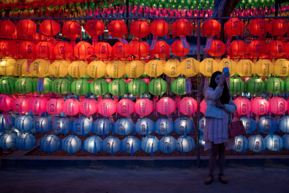 A woman takes a selfie during the Vesak Buddhist Ceremony  celebrating Buddha's birth at the Jogyesa Temple on May 6, in Seoul, South  Korea. The lantern festival will be held until May 11. As the exact birthday of  Buddha, born 2,558 years ago is unknown, South Korea celebrates his birthday on  the full moon of May, which is May 6 this year.       Chris McGrath/Getty Images