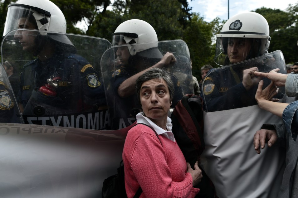 Civil servants face riot forces as they demonstrate against  austerity measures imposed under the debt-mired country's international bailout  commitments in central Athens, on May 6.       ARIS MESSINIS/AFP/Getty Images