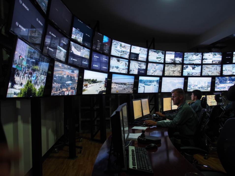 A  semi-circle of LCD screens allows the police to examine 108 camera feeds in  Kabul. Over the next six months, full maintenance of the surveillance system  will be transitioned from the care of security contractors to the Kabul police.  Maintenance of the cameras alone costs $2 million a year, and now that  Afghanistan is receiving less foreign aid, the police are looking for ways to  manage the cost.      Deni  Béchard