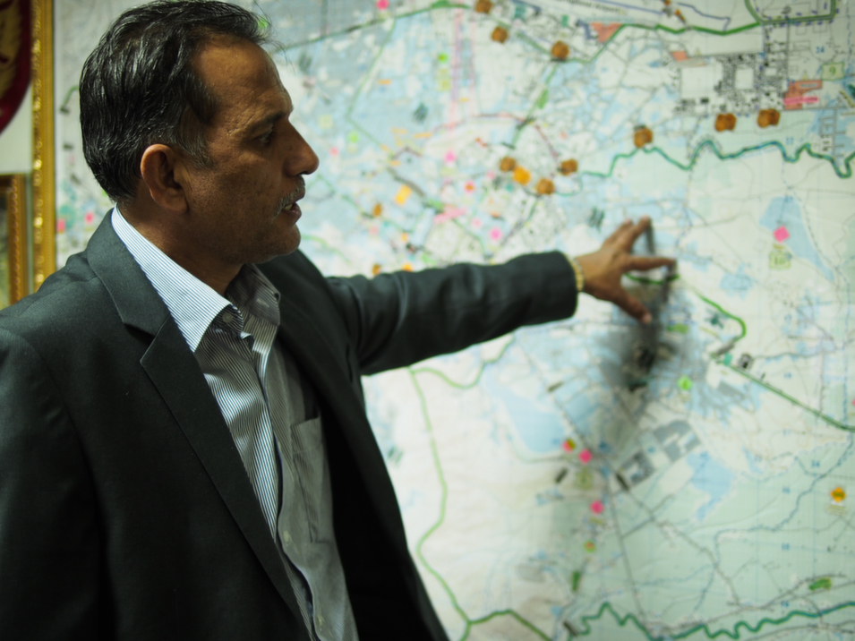 """Major  General Zahir Zahir, commander of the Kabul City Police, stands in front of a  map of Kabul, explaining the different areas of the city and how they are  monitored. Zahir has been commander for two years and, during that time, he's earned a reputation for cracking down on corruption and  kidnappings of wealthy Afghans. Not long after being promoted, he led a team that captured one of  Afghanistan's most wanted criminals, Habib Istalif, the head of an organized crime ring who has since been sentenced to death. Even as  demonstrators pass outside the police station to protest election fraud, they shout, """"Long live General Zahir"""" to show their  respect.       Deni  Béchard"""