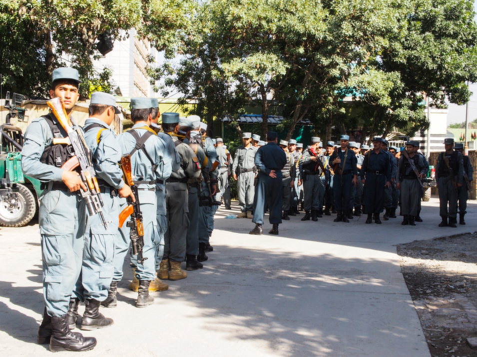 Police officers inside the headquarters compound prepare to monitor and direct street  demonstrations by the supporters of presidential candidate Abdullah Abdullah.  Whereas Kabul province has only 4,000 Afghan National Army soldiers, the Kabul police force has  between 14,000 and 15,000 officers.       Deni  Béchard