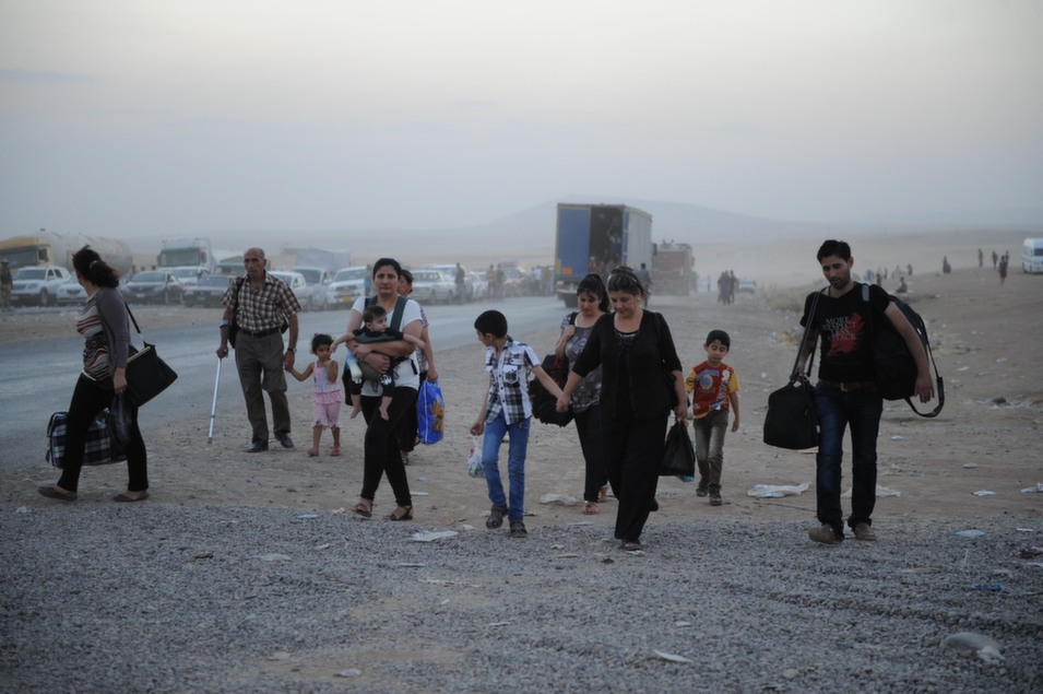 Yazidis and Christians  flee Mosul and seek refuge in the Kurdish capital of Erbil as the city falls to  the Islamic State on Aug. 6.      Mustafa Kerim/Anadolu  Agency/Getty Images