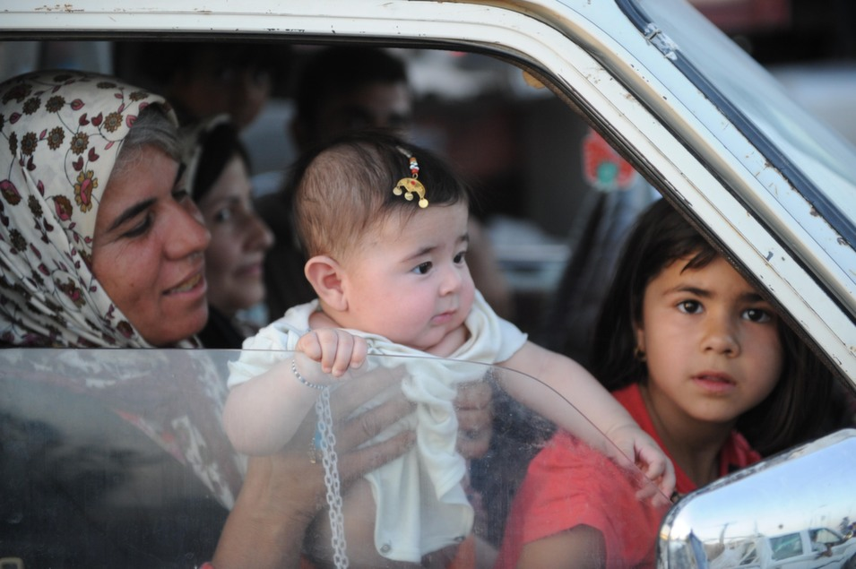 A Yazidi family waits in a traffic jam as thousands flee Mosul,  Iraq's second-largest city.      Mustafa Kerim/Anadolu  Agency/Getty Images
