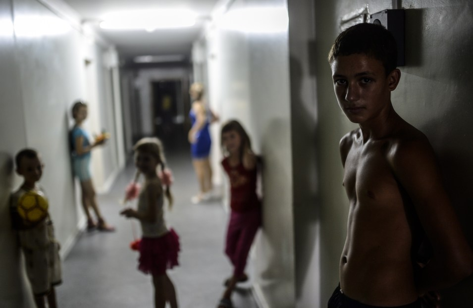 A boy stands with other children in a hallway in a refugee hostel run by pro-Russian rebels in the center of Donetsk, on Aug. 4.      Bulent Kilic/AFP/Getty Images