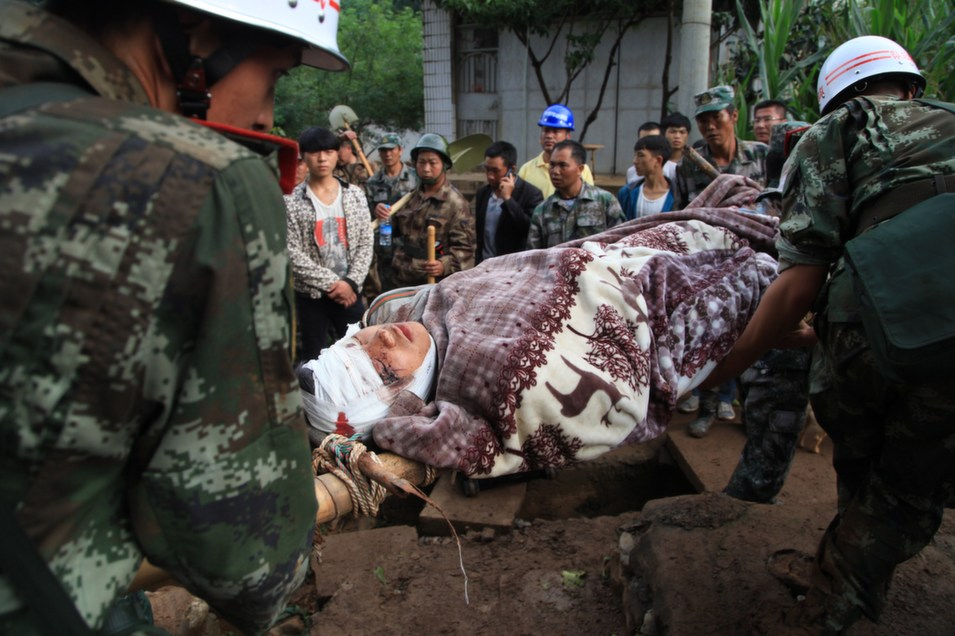 Rescuers carry an injured earthquake victim in Ludian county in Zhaotong, southwest China's Yunnan province on Aug. 4.      STR/AFP/Getty Images
