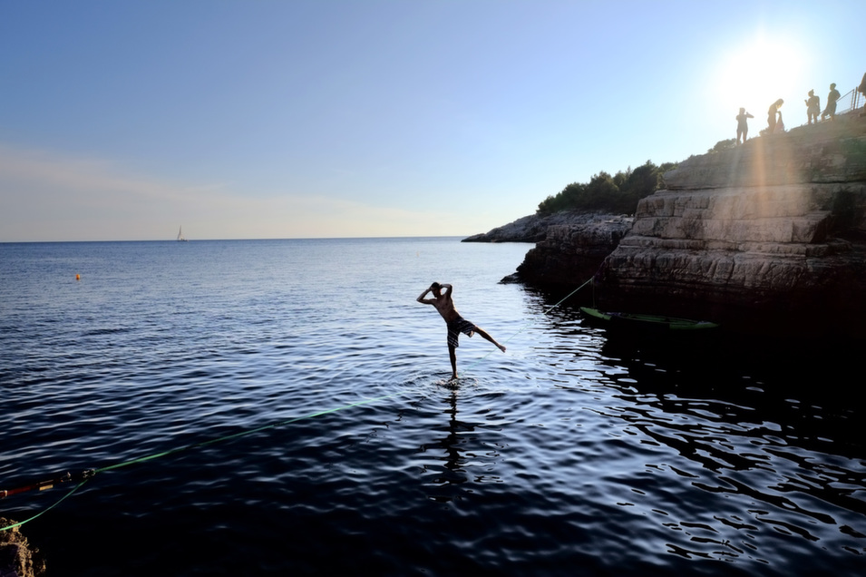 A climber walks over a slackline at the cliffs of Stoja on Aug. 5 near Pula, Croatia.      Thomas Lohnes/Getty Images