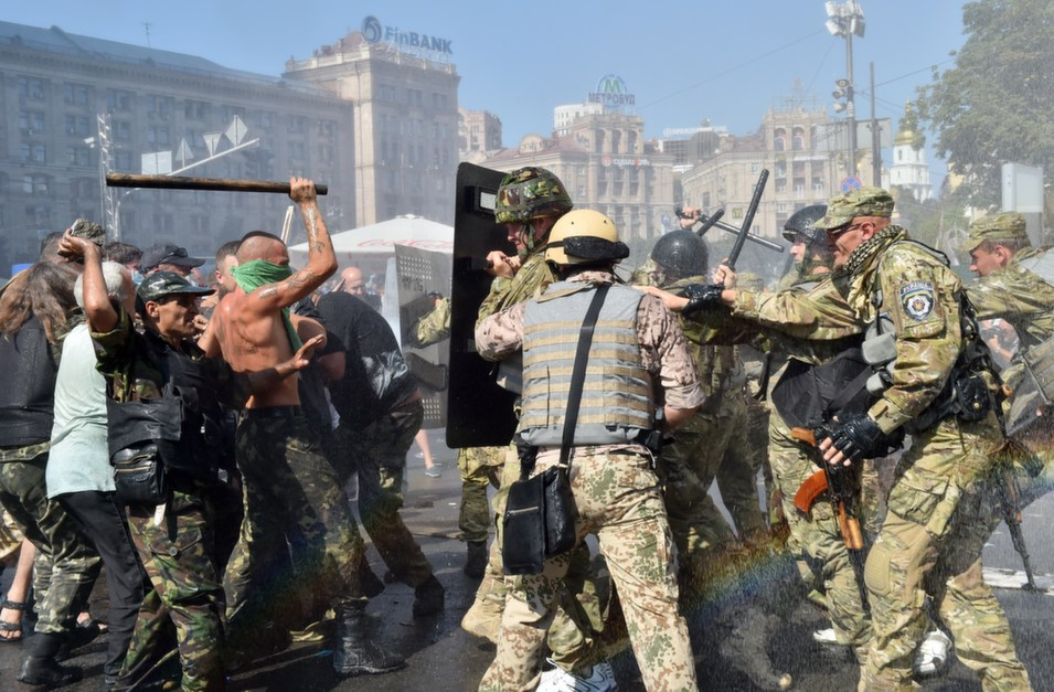 Maidan self-defense activists clash with fighters of Kiev-1 volunteer battalion on Independence Square in Kiev on Aug. 7.      Sergei Supinsky/AFP/Getty Images