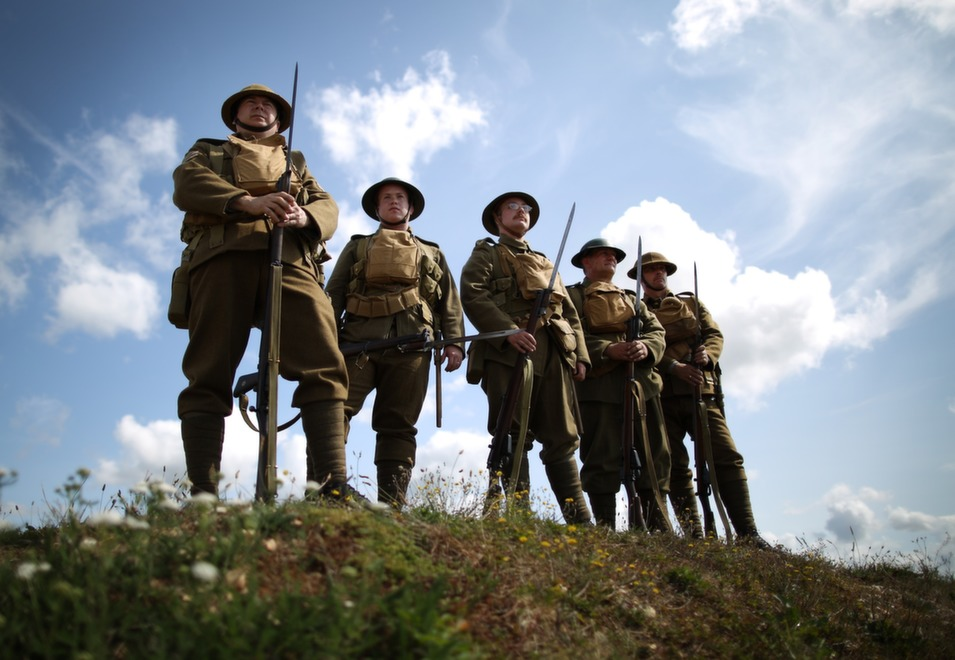 Members of the Great War Society living history group dressed as 4th Battalion the Middlesex Regiment wait to take part in a World War One centenary ceremony at the Tank Museum, Bovington on Aug. 4 in England.       Photo by Peter Macdiarmid/Getty Images