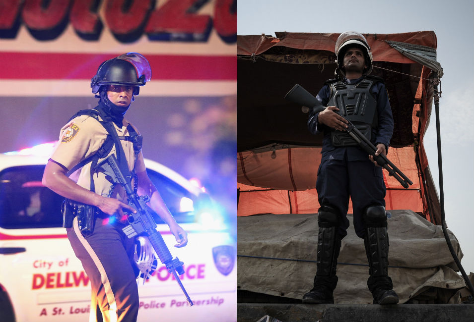 Left: A police officer patrols downtown  Ferguson on the night of Aug. 13. Police fired rubber-coated bullets at  demonstrators.       Right: A Bahraini policeman watches the road  that runs through the market in the village of Jidd Hafs, west of Manama, on  Aug. 14, 2013. The police fired  birdshot and tear gas at protesters, successfully stopping opposition  activists from gathering outside the U.S. embassy in Manama.