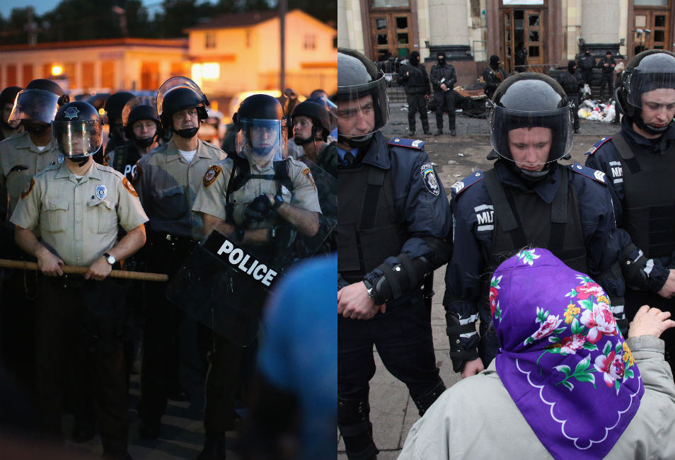 """Left: Riot  police look on as protesters in Ferguson gather to demonstrate against police  brutality in the wake of Brown's murder.      Right: A pro-Russian protester faces off against  riot police in Kharkiv, Ukraine. The pro-Russian demonstrators had occupied a  government administration building before being driven  out by police on April 8, in an operation that  the government described as an """"anti-terrorist operation."""""""