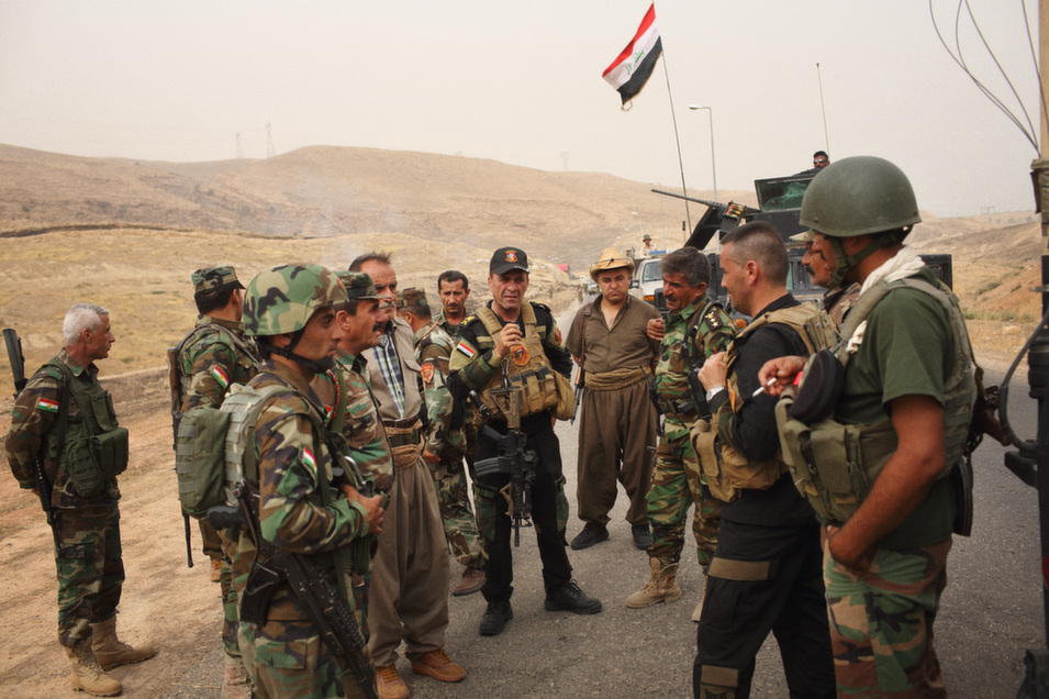 Iraqi  army commander Maj. Gen. Fadhil al-Barwari (seen center) is surrounded by Iraqi  and Kurdish soldiers as they advance on IS after re-taking Mosul dam overnight.
